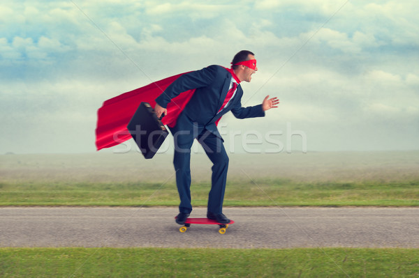 superhero businessman riding a skateboard Stock photo © leeavison