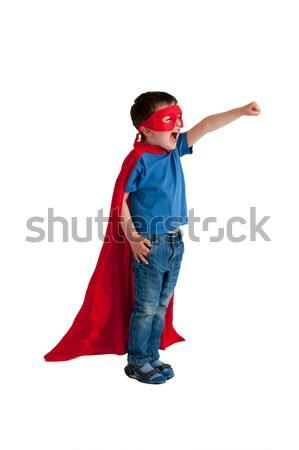 Superhero мальчика изолированный белый ребенка счастливым Сток-фото © leeavison
