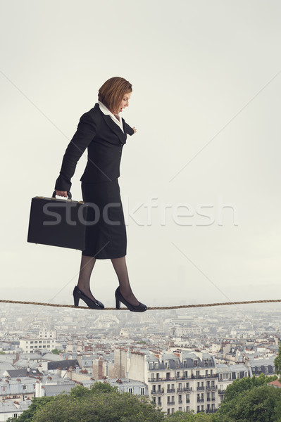businesswoman walking a tightrope Stock photo © leeavison