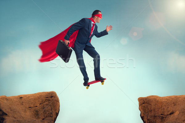 funny superhero businessman on a skateboard Stock photo © leeavison
