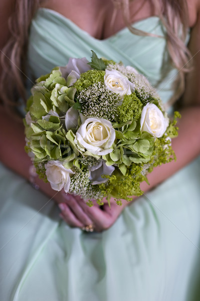 bridesmaid in green with wedding bouquet Stock photo © leeavison