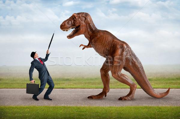 Ellenséges üzlet üzletember fogak ötlet fegyver Stock fotó © leeavison