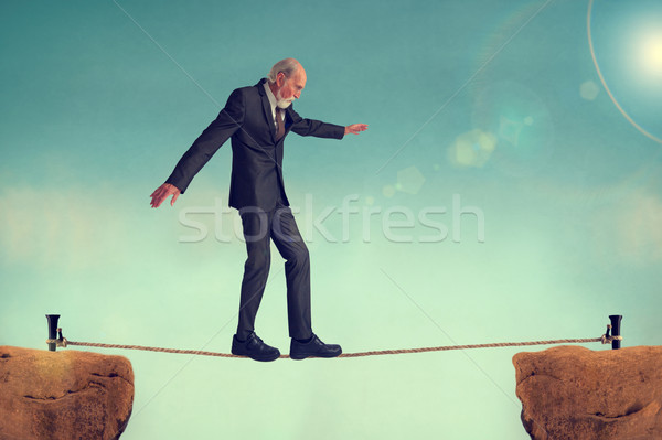 senior man walking a tightrope Stock photo © leeavison
