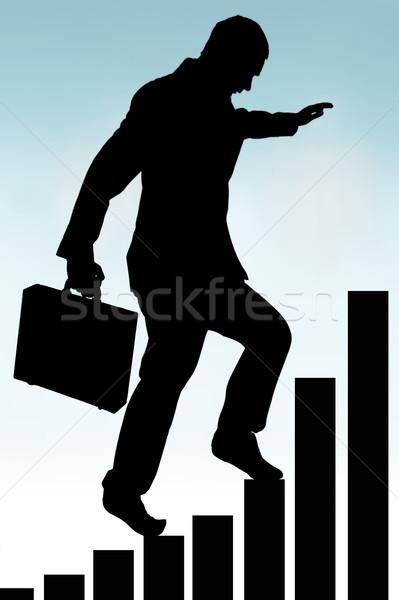businessman climbing a bar chart silhouette  Stock photo © leeavison