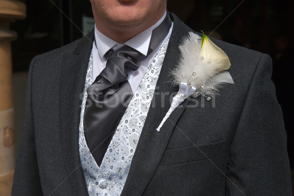 groom with lily buttonhole flower Stock photo © leeavison