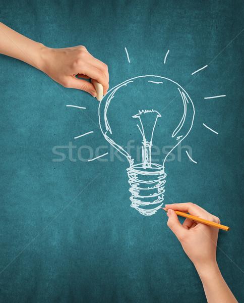 Idea Background With Human Hand Stock photo © leedsn