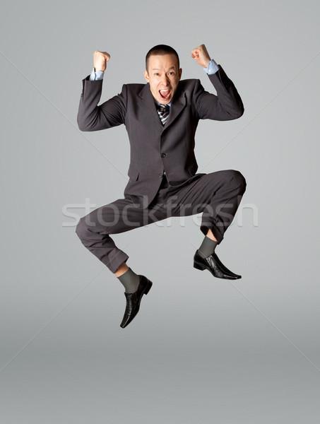 Gelukkig zakenman springen lucht geïsoleerd witte Stockfoto © leedsn