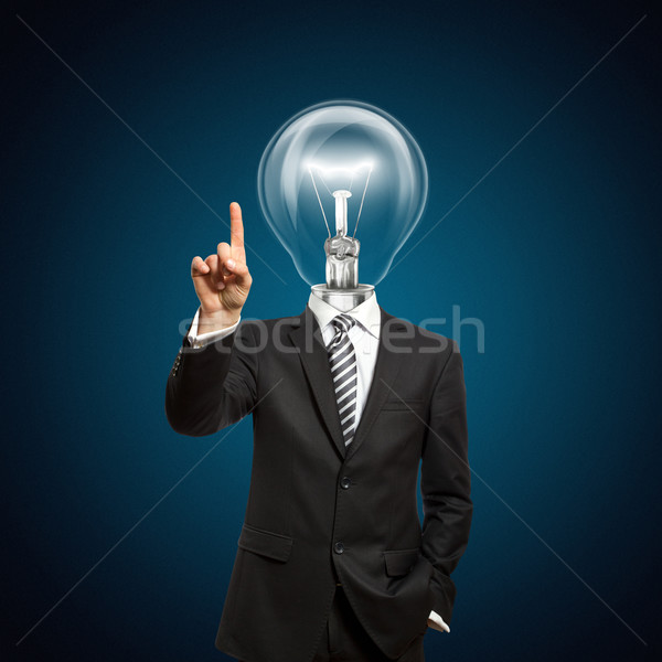 businessman with lamp-head push the button Stock photo © leedsn