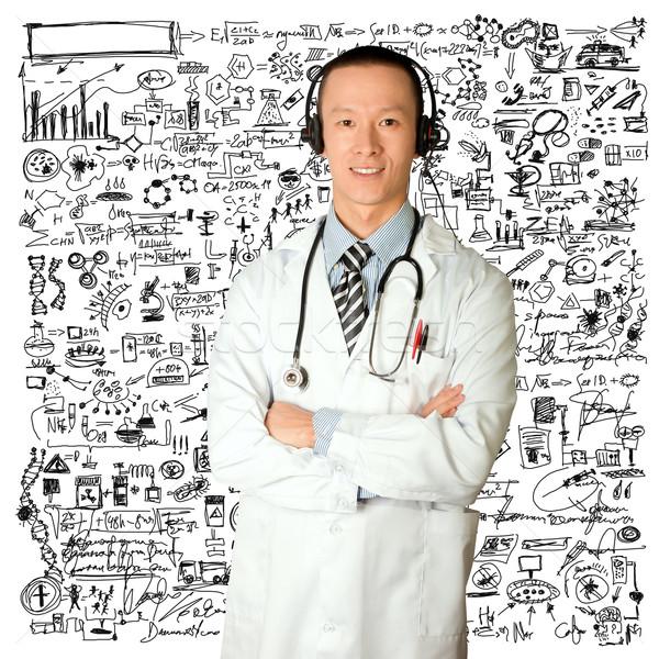 doctor with headphones Stock photo © leedsn
