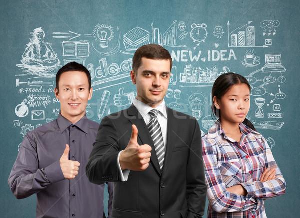 Zdjęcia stock: Asian · zespołu · lampy · głowie · ludzi · biznesu · laptopy
