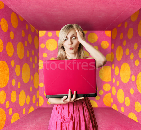 blonde in pink dress with laptop Stock photo © leedsn