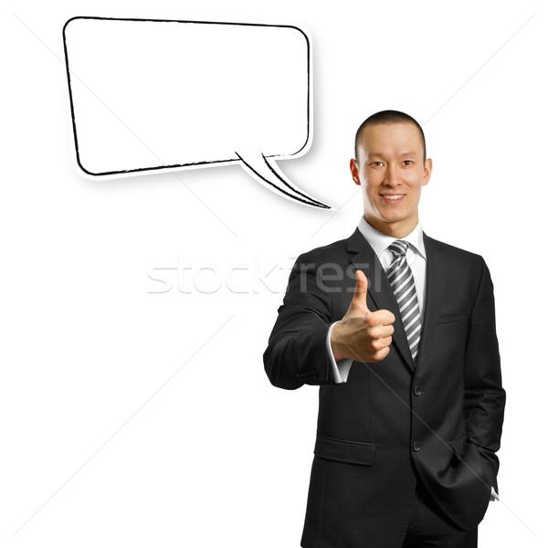 Asia masculina traje manos burbuja de pensamiento mirando Foto stock © leedsn