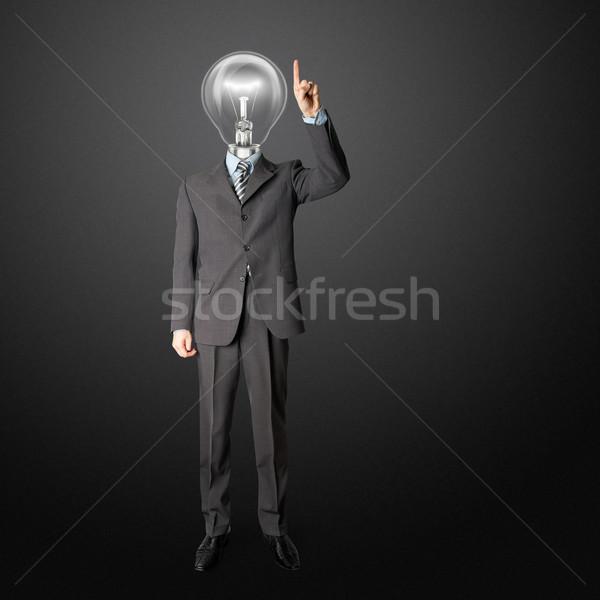 full length businessman with lamp-head push the button Stock photo © leedsn
