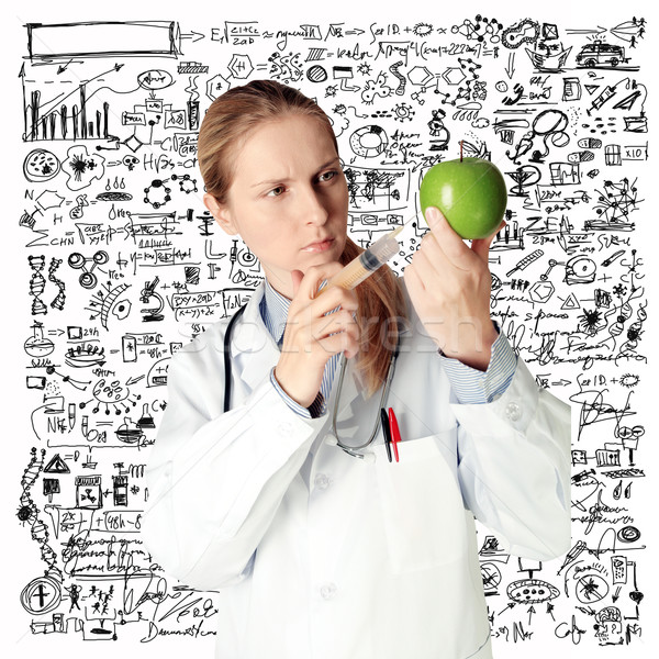 scientist woman with apple Stock photo © leedsn
