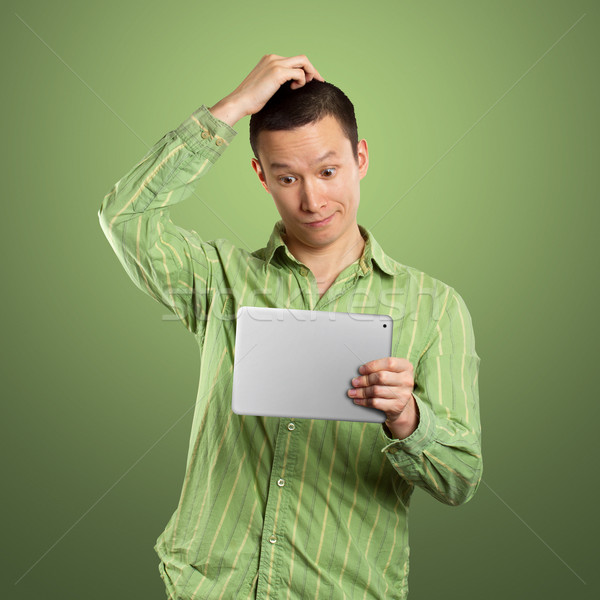 Business Man With Touch Pad Stock photo © leedsn