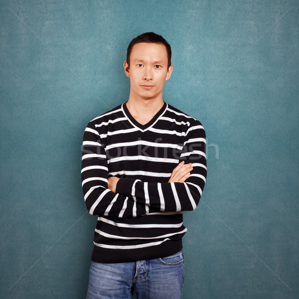 Asian Man In Striped Pullover Stock photo © leedsn