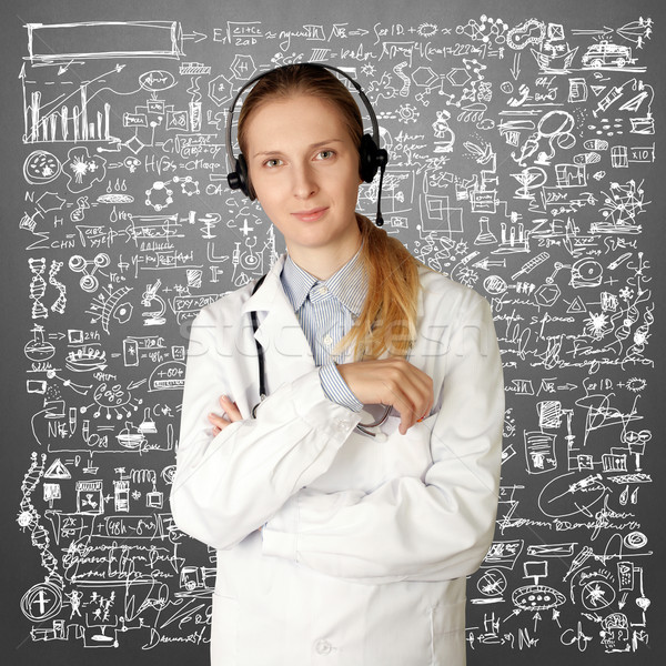 doctor woman with headphones smile at camera Stock photo © leedsn