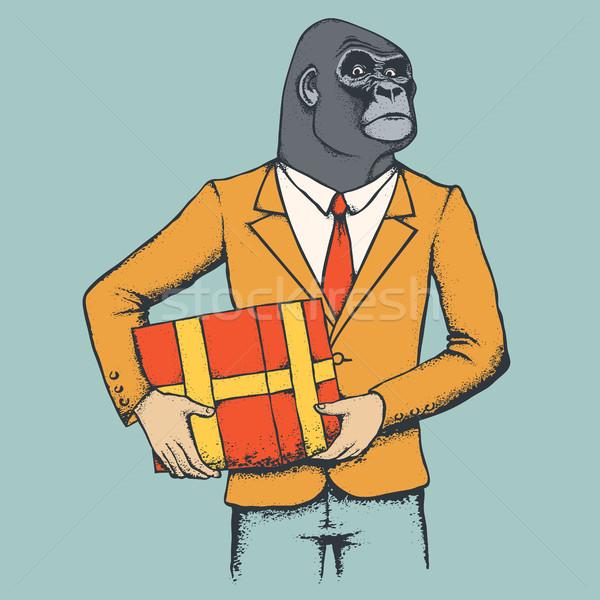 Majom gorilla afrikai emberi öltöny ajándék Stock fotó © leedsn