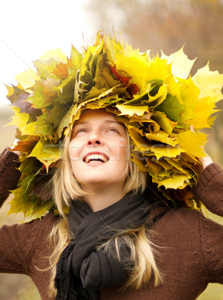 Woman with autumn wreath outdoors Stock photo © leedsn