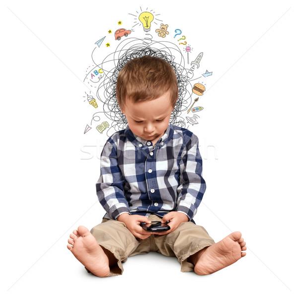 Pequeño nino pensando teléfono nino barco Foto stock © leedsn