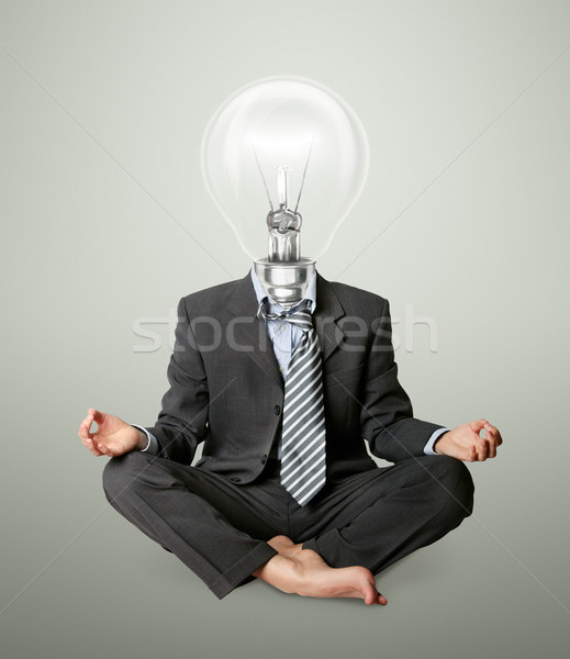 Stock photo: businessman in lotus pose and lamp-head