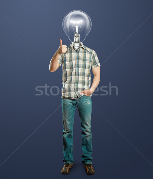 full length man with lamp shows well done Stock photo © leedsn