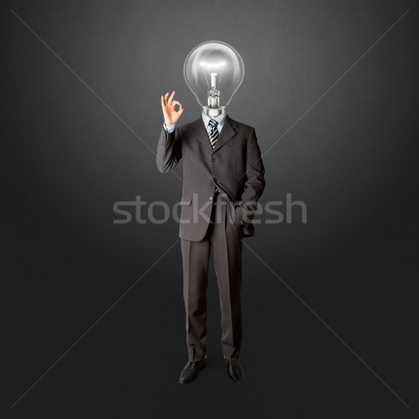 full length business male with lamp-head Stock photo © leedsn