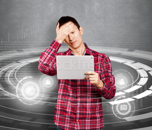 Asian Man With Touch Pad Stock photo © leedsn