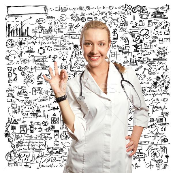 young doctor woman shows ok Stock photo © leedsn