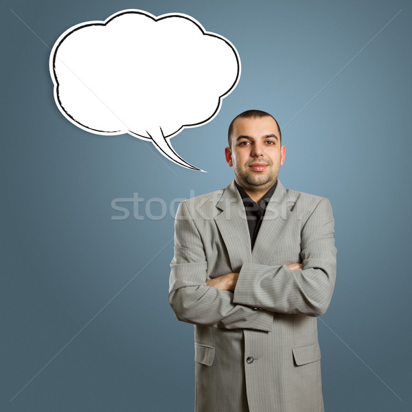 male in suit with crossed hands and speech bubble Stock photo © leedsn