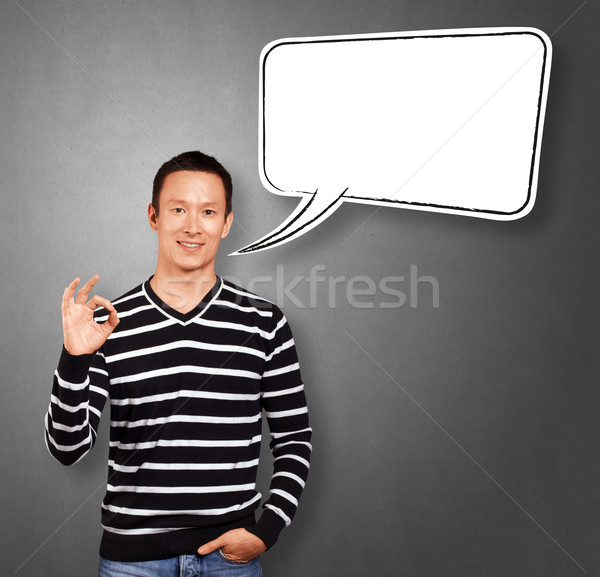 Asian Man In Striped with Speech Bubble Stock photo © leedsn