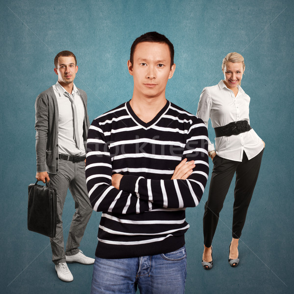 Teamwork and Asian Man In Striped Pullover Stock photo © leedsn