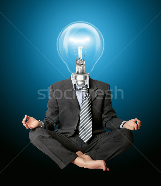 businessman in lotus pose and lamp-head Stock photo © leedsn