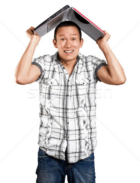 Man Hides Under The Laptop Stock photo © leedsn