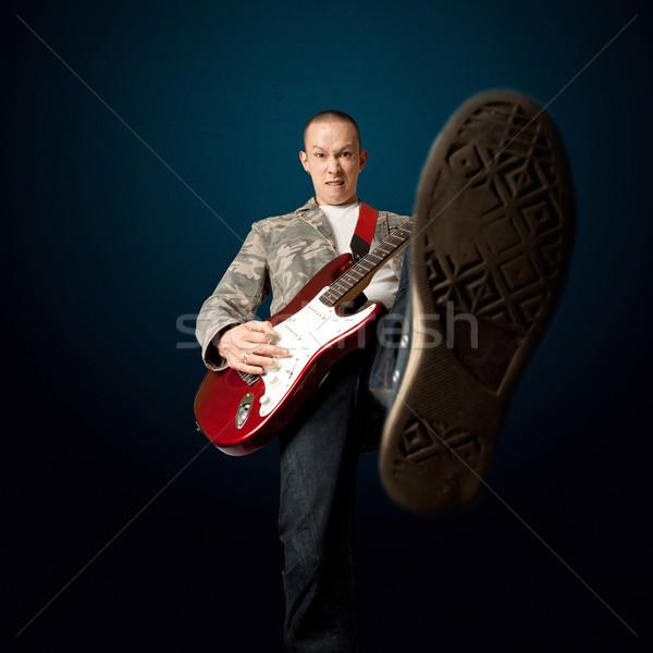 рокер гитаре ногу электрической гитаре камеры человека Сток-фото © leedsn