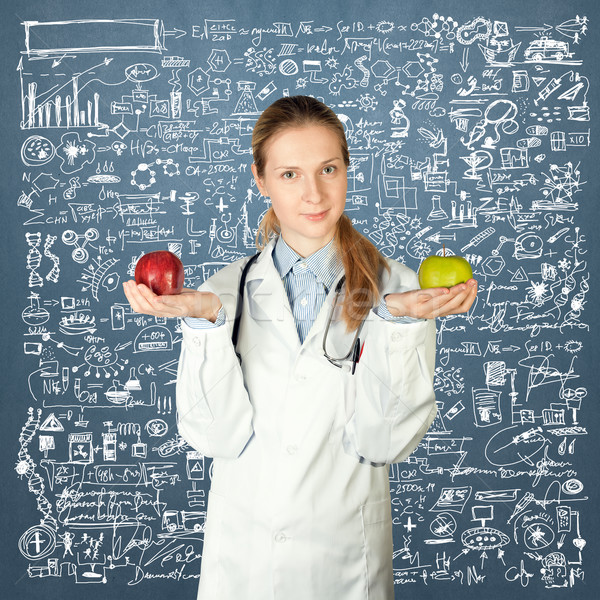 female doctor with two apples Stock photo © leedsn
