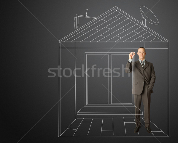 asian businessman with marker in fictional house Stock photo © leedsn