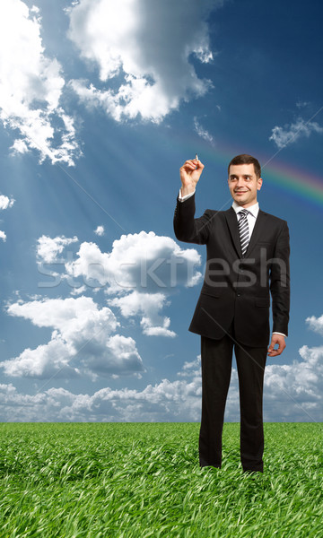 businessman writting something with marker outdoors Stock photo © leedsn