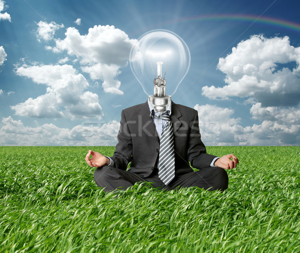 businessman in lotus pose and lamp-head in grass Stock photo © leedsn