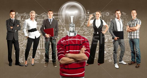 Business team lamp hoofd idee verschillend achtergronden Stockfoto © leedsn