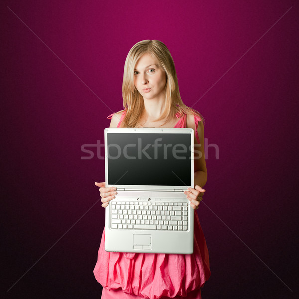 femaile in pink with open laptop Stock photo © leedsn