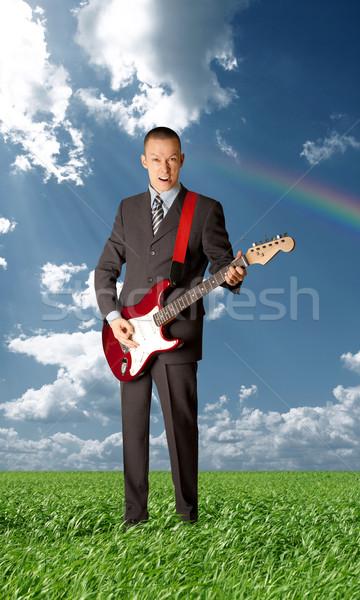 asian guitarist playing outdoors Stock photo © leedsn