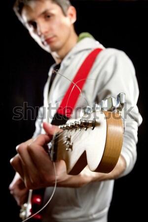 Adam gitar kırmızı oynama müzik konser Stok fotoğraf © leedsn