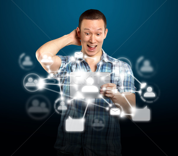 Man With I Pad in Social Network Stock photo © leedsn