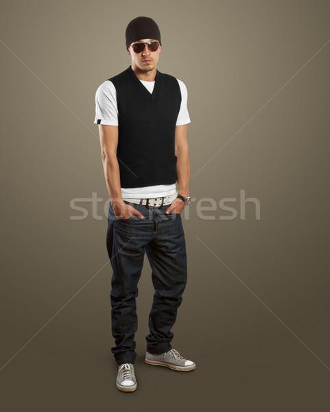 stylish man in glasses looking at camera Stock photo © leedsn
