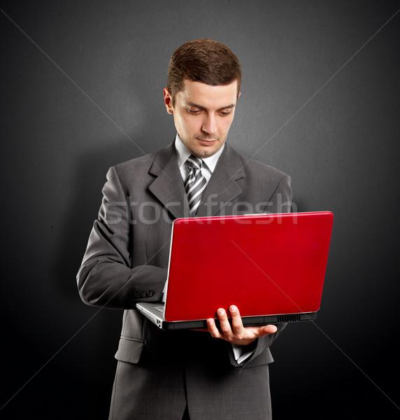 Człowiek biznesu laptop czerwony ręce strony biznesmen Zdjęcia stock © leedsn