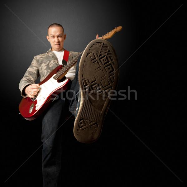 рокер гитаре ногу электрической гитаре камеры музыку Сток-фото © leedsn