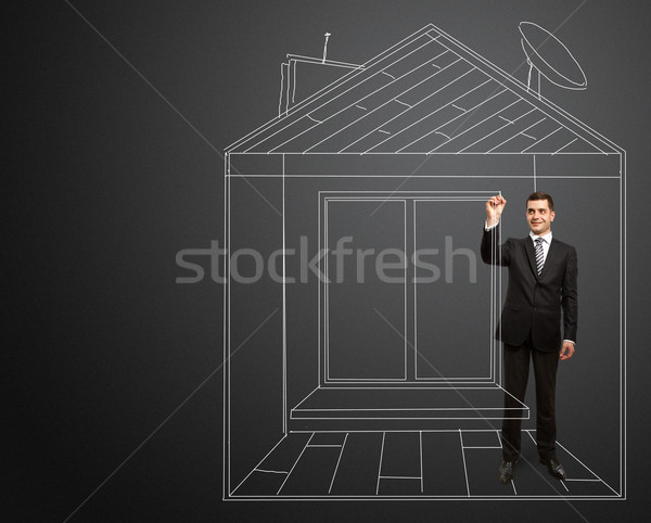 businessman with marker in fictional house Stock photo © leedsn