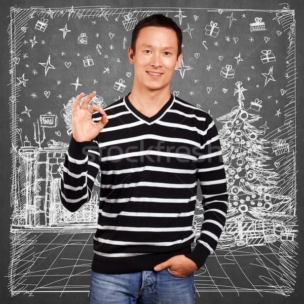 Hombre mirando Navidad regalos cara Foto stock © leedsn