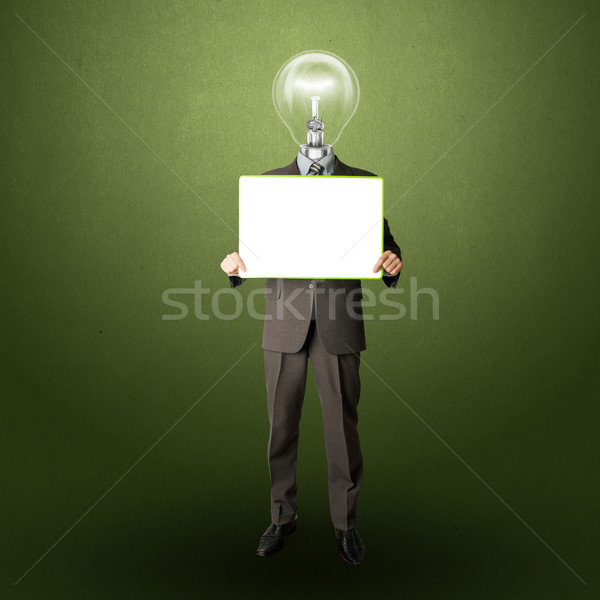 happy businessman with lamp-head holding card Stock photo © leedsn